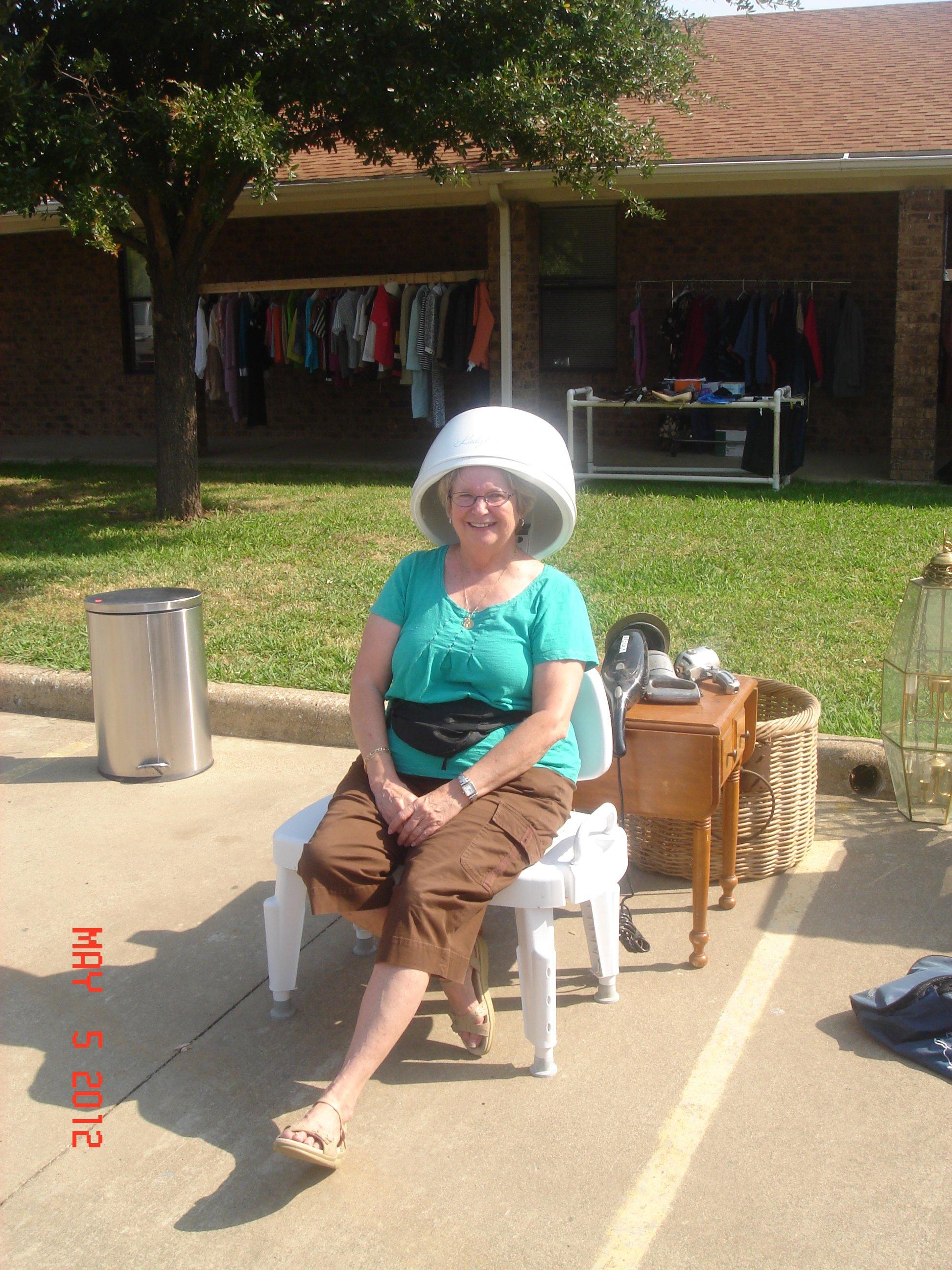 Rummage Sale lady sitting in hair dryer