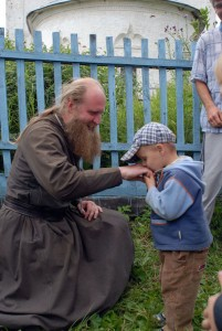 kissing a priest's hand